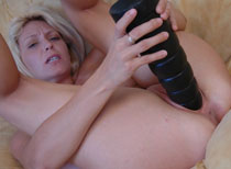 Charlie fucking her pussy with a brutal dildo
