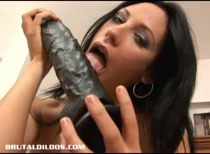 Marty filling her sexy russian mouth and wet pussy with two giant sized dildos
