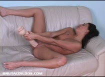 French and Tanned Sandy pushes her tight pussy to the limit with two huge dildos