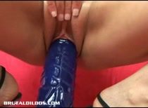 Amber Rayne filling her once tight asshole with a massive brutal dildos and cumming