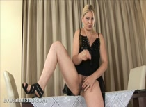 Classy blonde Ionella fills her hairy pussy with a big brutal dildo and cums hard!