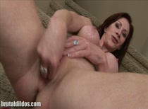 Redhead cougar Catherine punishes her pussy first and asshole next with huge dildos!